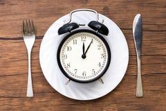 äta tid till Äta lunch Tid, frukosten och matställebegreppet arkivfoton