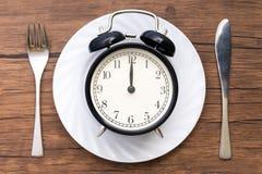 äta tid till Äta lunch Tid, frukosten och matställebegreppet arkivbild