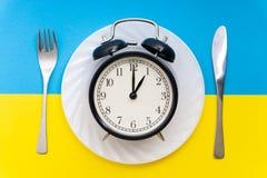 äta tid till Äta lunch Tid, frukosten och matställebegreppet arkivfoto