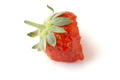 äten half jordgubbe arkivbild