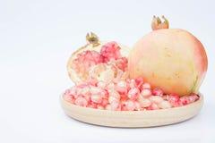 Äter sund frukt för granatäpplen ny frukt eller fruktsaft Arkivbild