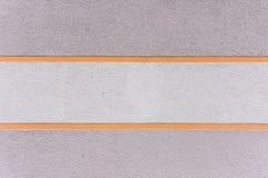 Äußere Wand mit vergipsten Bereichen in den grauen, gelben Streifen Lizenzfreie Stockfotos