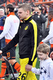 Łukasz Piszczek and child Royalty Free Stock Photo