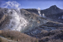 Ōwakudani  & x22;Great Boiling Valley& x22; ,volcanic valley. Ōwakudani  & x22;Great Boiling Valley& x22; is a volcanic valley with active sulphur vents and Royalty Free Stock Photos