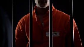 反对监狱酒吧的被判罪的凶手身分,监禁为绑架 库存图片