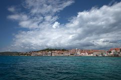 Šepurine village on island of Prvić, Adriatic Sea, Croatia. Stormy clouds overhanging old, idyllic, mediterranean village Šepurine with crowded, stone built Royalty Free Stock Photography