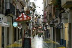 多雨蘑菇的街道在阿利坎特 免版税库存图片