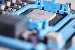 在主板安装的宏观摄影微处理器 免版税库存图片