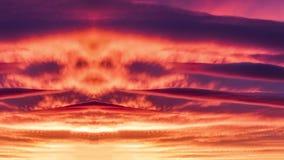 在天空的面孔在红色云彩 库存照片