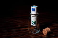 20在瓶里面的欧元钞票 图库摄影