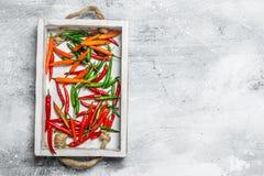 在盘子的辣美味胡椒 免版税图库摄影