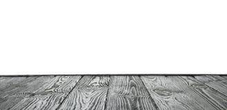 在白色的空的木桌表面 设计的大模型 免版税库存图片