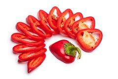 在白色背景的圆环切的红色甜椒隔绝了顶视图特写镜头 图库摄影