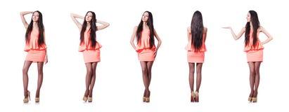 在白色隔绝的桃红色短的礼服的俏丽的女孩 库存图片