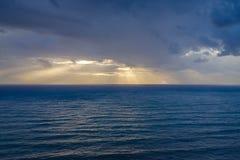 在黑暗的五颜六色的日落看见 图库摄影