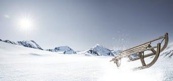 在雪的雪撬 图库摄影