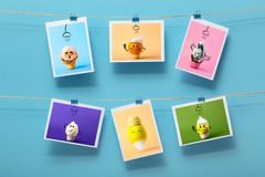 图片用垂悬在文具夹子的一条亚麻制螺纹的滑稽的洗涤的果子在色的背景,快乐的心情的概念 库存图片