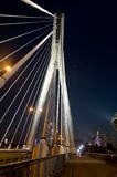 �wi�tokrzyski Bridge in Warsaw  - hanging ropes in night Stock Photo