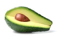 Świeży avocado plasterek na białym odosobnionym tle Zakończenie zdjęcie stock