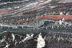 Åder i stenen - polerad granittextur royaltyfria foton
