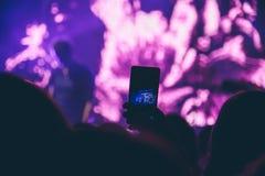Åhörarna på en konsert Arkivfoto