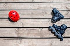 Åka skridskor utrustning på träbrädena Fotografering för Bildbyråer