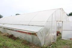 Åkerbrukt växthus Arkivfoto