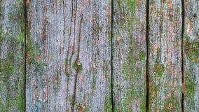 Åldrades träplankor med knäckt bleknade blå målarfärg arkivbild