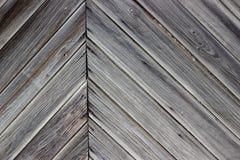 Åldras väggen av träbyggnaden som bakgrund eller textur arkivbild