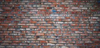 Åldrig bakgrund för vägg för röd tegelsten Arkivfoton
