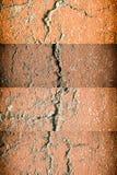 Åldrig cementväggtextur som är sprucken vaggar bakgrund, grov yttersida Arkivbilder