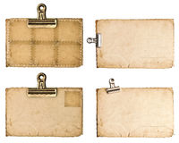 Åldriga pappers- ark med metallgemet som isoleras på vit Royaltyfria Bilder