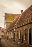 Åldrigt foto av en gammal gränd i Leiden, Holland Royaltyfri Foto