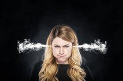 Ånga eller röka från öronen av flickan Royaltyfri Fotografi