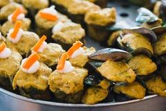 Ångade fisk och musslor med currydeg Fotografering för Bildbyråer