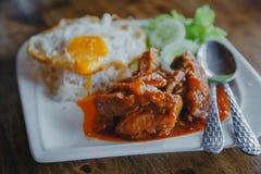 Ångade griskött och ris Arkivbild
