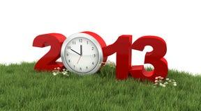 År 2013 med klockan i gräset   Royaltyfria Bilder