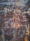År av erosion av metallyttersidan Arkivbilder
