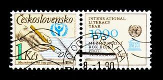 År för UNESCOvärldsläs-och skrivkunnighet, serie, circa 1990 Fotografering för Bildbyråer