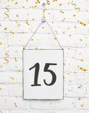 15 år gammalt kort för födelsedagparti med nummer femton med guld- Arkivbilder