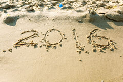 År 2016 på stranden för bakgrund Fotografering för Bildbyråer