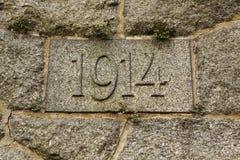 År 1914 som snidas i stenen År av världskrig I Royaltyfria Foton