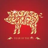 Året av svinet lyckligt nytt år också vektor för coreldrawillustration Bild av ett guld- svin på en röd bakgrund Arkivfoto