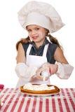 Årig flicka härliga lyckliga sju i kocklikformig med shortca Arkivbild