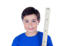 Årig pojke tio med en meter av trä Fotografering för Bildbyråer