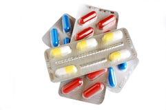 åstadkommer blåsor på färgrika pills Arkivfoton