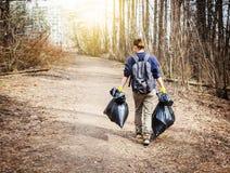 Återanvänd förlorad kull rackar ner på utbildning för rengöring för avskrädeavfallskräp royaltyfria foton