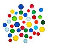 Återanvänd plast- kapsyler, färgplast-lock Arkivbild