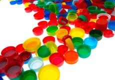 Återanvänd plast- kapsyler, färgplast-lock Arkivfoton
