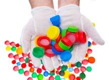 Återanvänd plast- kapsyler, färgplast-lock Royaltyfria Foton